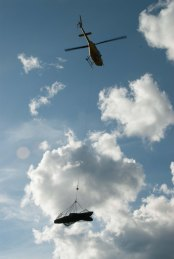 Helicopter transporting canoe - Hart River